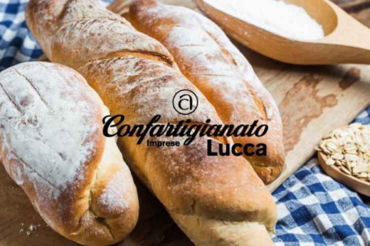 Image of bread on a cutting board with the Confartigianato Lucca logo
